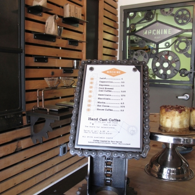 Menu Panel with Gears and Full View of Cafe