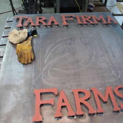 Final Placement of Hand Cut Cor-Ten Steel Letters