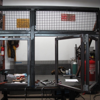 Final Fit Up of Bi-Fold Steel Windows on the Booth